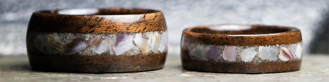 Wood rings with sand and seashell inlay