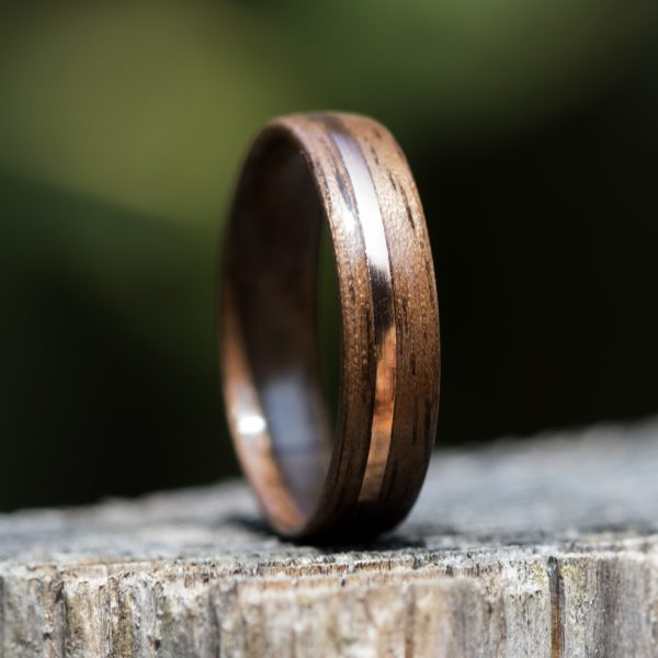Walnut wood ring with copper inlay