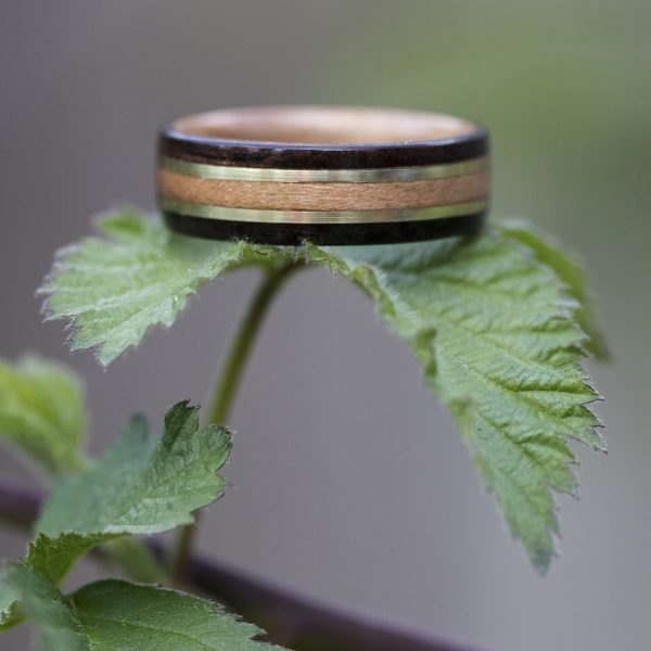 Ebony bentwood ring lined with cherry and inlaid with yellow brass and cherry