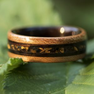 Cherry wooden ring lined ebony and tiger eye, obsidian, and ebony wood inlay