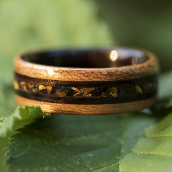 Cherry wooden ring lined ebony and tiger eye, obsidian, and ebony wood inlay
