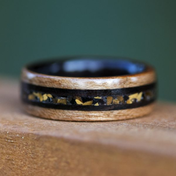 Cherry wood ring inner lined with ebony and inlaid with tiger eye, obsidian, and ebony wood