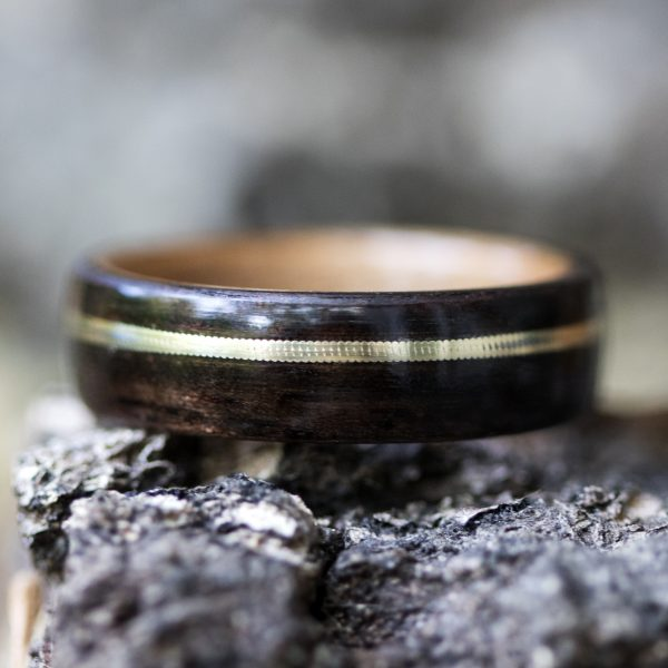 Ebony wood ring inner lined with cherry and inlaid with a guitar string