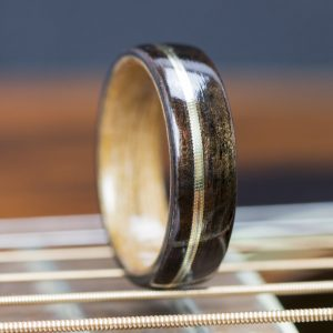 Ebony wooden ring lined with cherry and guitar string inlay