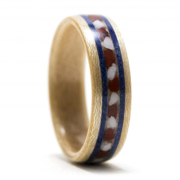 Maple wood ring inlaid with red jasper, howlite, and lapis lazuli