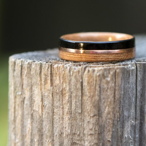 Cherry and ebony wooden ring lined cherry and inlaid with copper