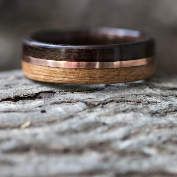 Ebony and cherry wood ring inner lined with ebony and copper inlay