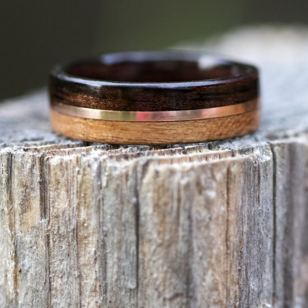 Ebony and cherry wooden ring lined ebony and inlaid with copper
