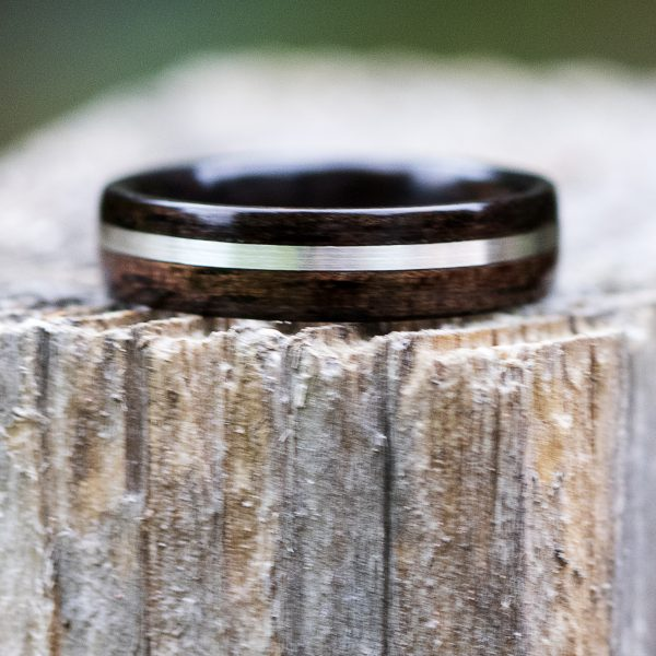 Ebony wooden ring with silver inlay