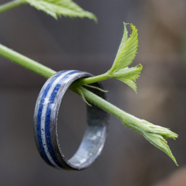 Gray birdseye maple wooden ring inlaid with lapis lazuli and howlite