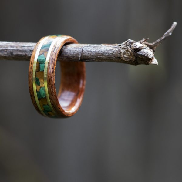 Mahogany bentwood ring inlaid with malachite, tigers eye, and yellow brass