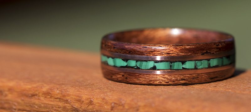 Mahogany wood ring inlaid with malachite stone and copper wire